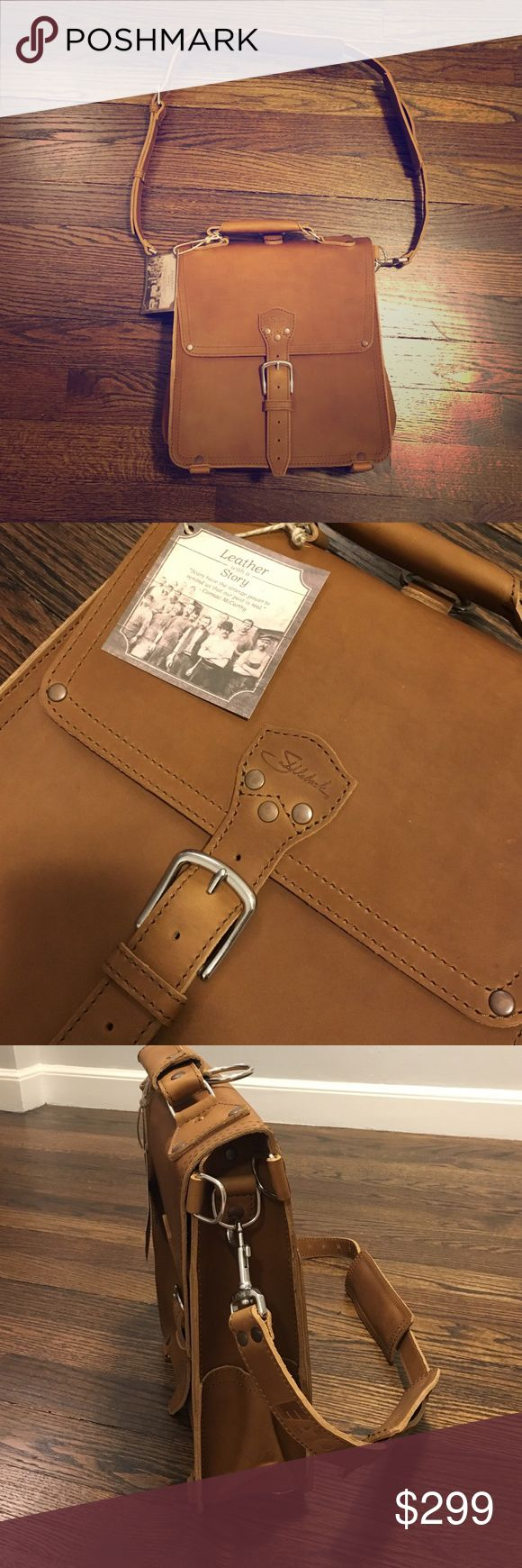 """NEW Saddleback Leather Messenger Bag 💼 Brand spanking new with tags!! Will break in beautifully.  Received as a gift and a company logo is blind stamped on the strap """"Eaton"""" - can be hidden with the strap pad or remove the strap all together and use as a backpack, it converts! Open interior (no divider) for maximum storage capacity 3 exterior pockets / 2 interior pockets  Adjustable strap length: 34 ½"""" - 59 ¼"""" Exterior: 12 ¾"""" W x 14 ½"""" H x 4 ¼"""" D Interior: 12 ½"""" W x 14"""" H x 4"""" D Holds up to…"""