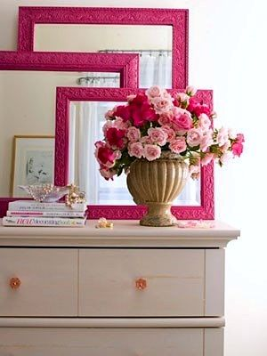 Brightly colored frames on stacked-mirrors that pick up other accent colors in the room.