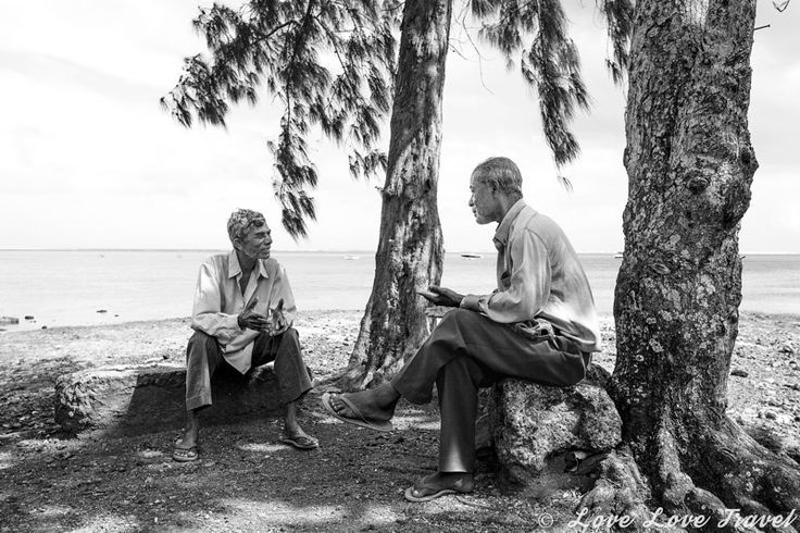 Solving the world's problems: Though Mauritius is the most densely populated country on the African continent - constantly bustling in the cities - the roads outside the cities were filled with relaxed scenes like this one. Two men sitting around chatting about life - real relaxed island vibes everywhere. Head over to our blog to get a glimpse of the Real Mauritius and its beautiful, colorful and friendly people in a stunning and honest photo essay.