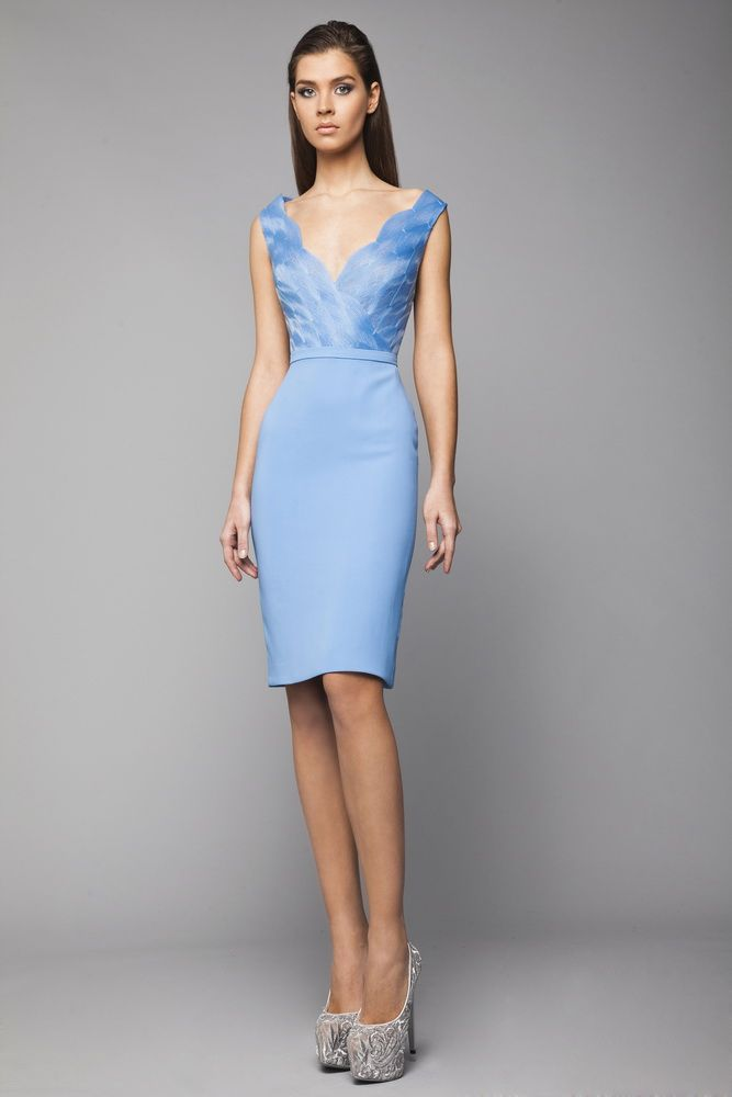 Fitted light Blue knee length dress in Moroccan Silk, with a V-neckline wrap bust made of a honeycomb Crinoline pattern.