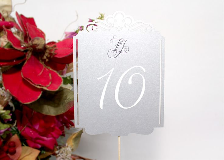 The custom numbers are hand painted on both sides using white ink pen, making them both highly functional and elegant on such event.