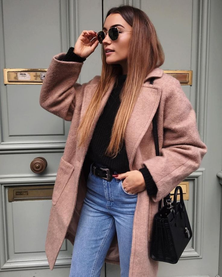Rose coat over black sweater and blue jeans.
