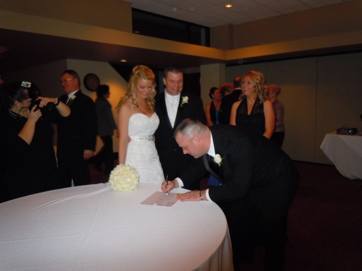 Best Man witnessing the Marriage Certificate.