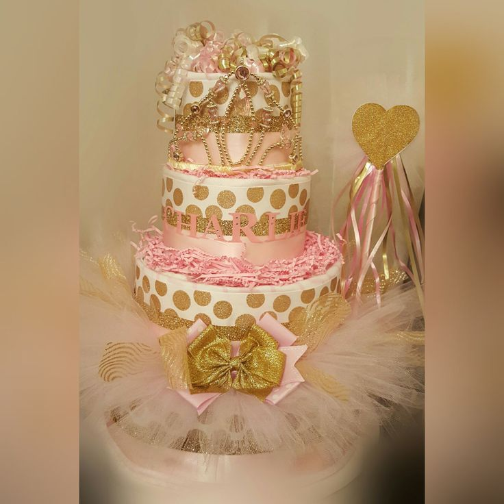 Princess Diaper Cake, Gold and Pink Diaper Cake, Princess Centerpiece, Gold and Pink Centerpiece by RibbonsandConfetti on Etsy https://www.etsy.com/listing/248784981/princess-diaper-cake-gold-and-pink
