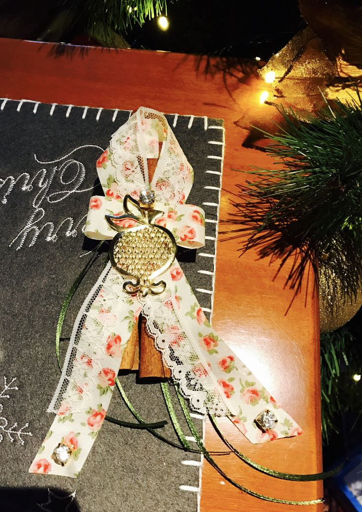 Romantic lucky charm with cinnamon sticks and floral ribbons