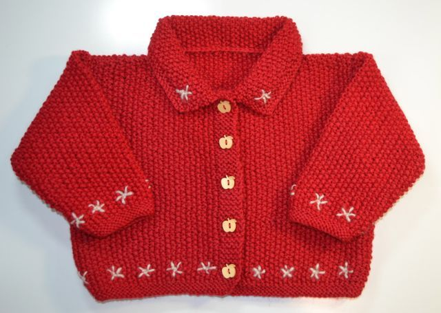 Red Apple Cardi.  Hand knitted, 100% wool cardigan with set in sleeves, button through front and collar.  Hand embroidered stars, and wooden apple buttons.  Warm and stylish.  One only.  Fits 12 months.  Girls - Emmie&Me handmade children's wear for ages 0 - 24 months
