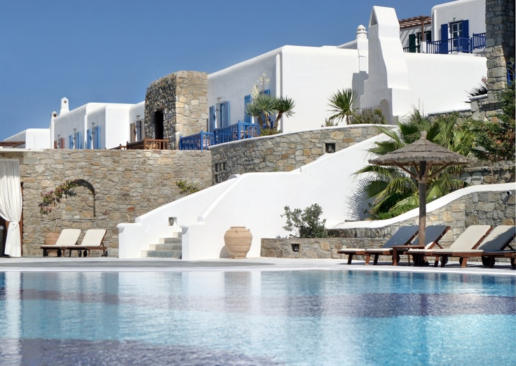 Grand staircase leading to pool area, next to contrasting combination of stone and lime surfaces, at Mykonos Grand Luxury Hotel