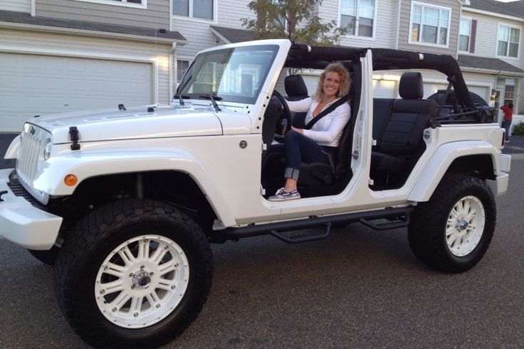 2012 Jeep Wrangler Unlimited Altitude. Everything is custom painted white.
