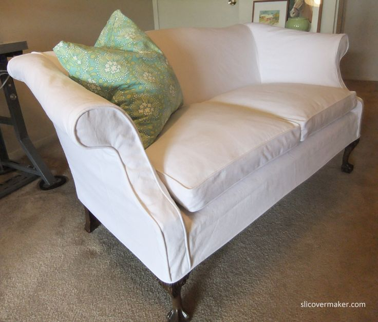 Washed, white denim slipcover looks great on feather seat cushions and curvy arms. #whiteslipcovers #slipcovermaker