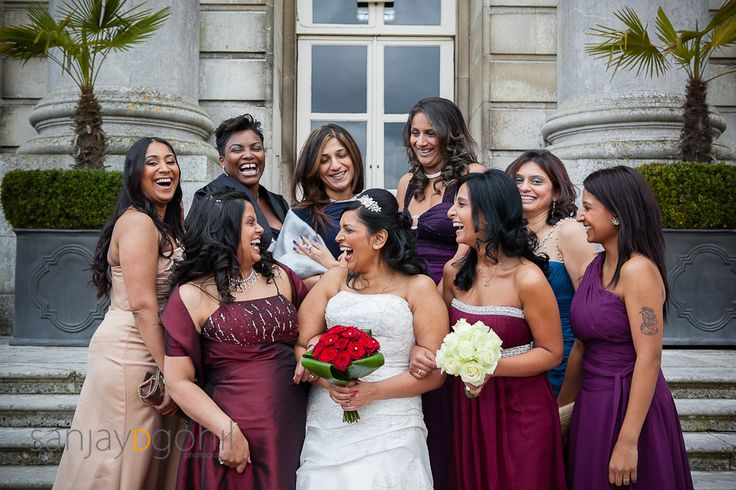Bride and Bridesmaid photograph with everyone laughing