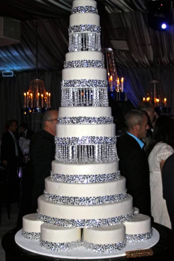 Tall bling wedding cake. I love this but I would want some detail and some flowers added to it.