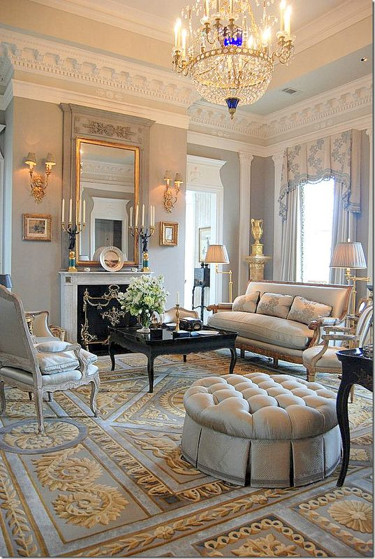 Absolutely gorgeous! The gray living room on the Piano Nobile floor. The gilt & wood console is one of the pieces made by the Hermitage Museum. The chandelier is reproduction from Russia. The plate on the mantel is from Alexander I. All rugs are by Hokanson. Love the gray silk curtains. Be sure to notice the molding – it is amazing, especially the architrave over the doors.
