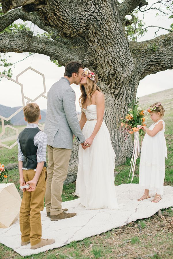 A romantic vow renewal with the kids, featuring modern and geometric details.
