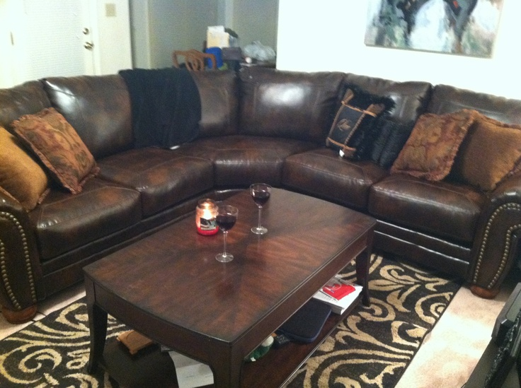 Ashley Furniture Sectional With Nailhead Detailing For