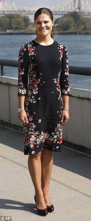 Crown Princess Victoria of Sweden coordinates with the Indian summer weather in a beautiful fitted floral dress on a visit to the United Nations. After seeing to official business, the mother-of-one blended in with the lovely blossoms after she struck a pose in a colorful flower garden along the East River.