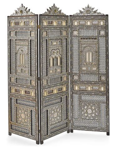 An impressive Levantine shell and bone inlaid hardwood three fold double sided floor screen