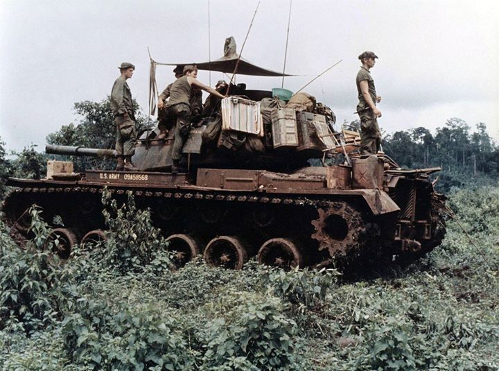 Men of Troop B 1st Squadron 10th Cavalry Regiment 4th Infantry Division and their M48 Patton tank move through the jungle in the Central Highlands of Vietnam June 1969.