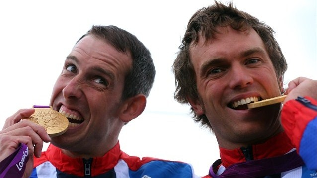 Tim Baillie and Etienne Stott of Great Britain pose with their gold medals during the Victory Ceremony after the men's Canoe Double (C2) Slalom final on Day 6 of the London 2012 Olympic Games at Lee Valley White Water Centre.
