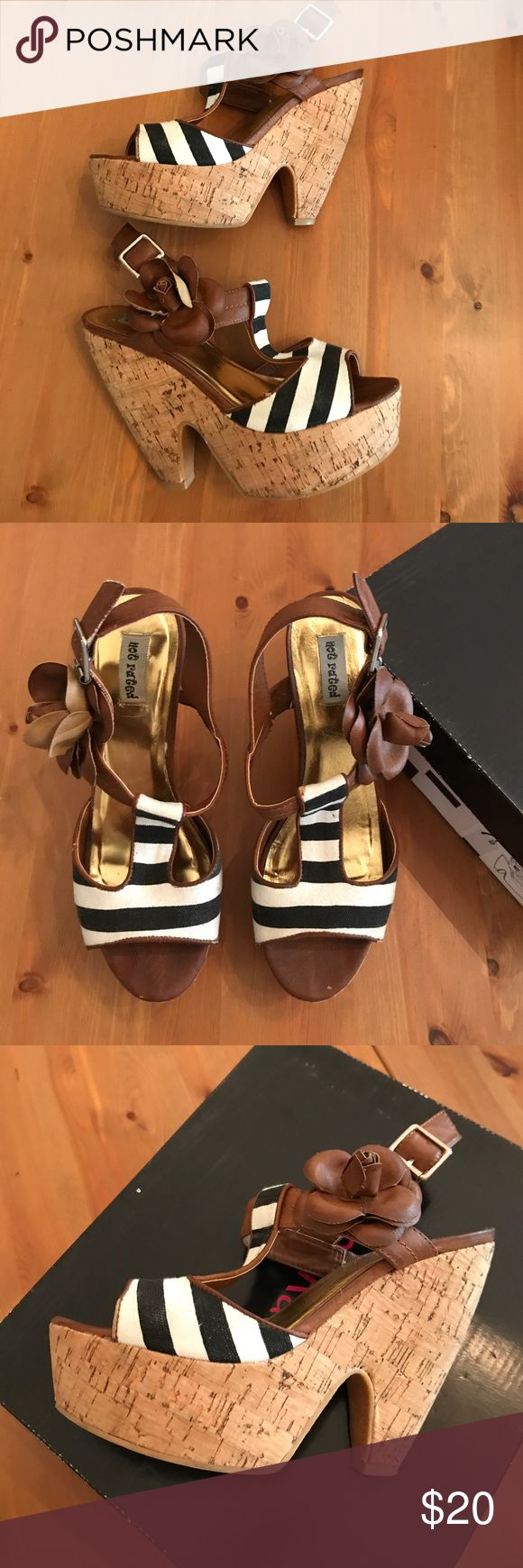 Stripe Platform Heels 7.5 Not Rated Treky heels in size 7.5. Love these shoes so much, but I just had a baby and they aren't going to get much wear anymore. I have worn them a few times so there is a little bit of wear to them. Check out out all the photos to see. Still in great condition though. Not Rated Shoes Heels