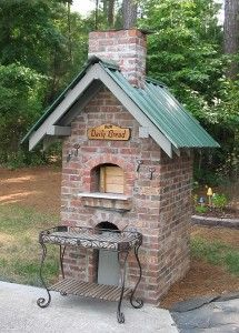 Free standing brick oven. Ahhhh, love the green roof! Surely I could cook more than pizzas iin this! LOL
