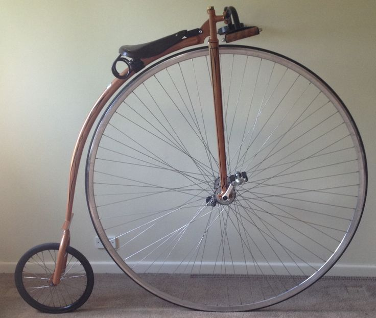 Beautiful hand built Penny Farthing in a copper finish with pinstripping and a polished rim built by pennyfarthingdan.com.au