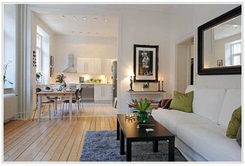 """I like how this unit doesn't try to mimic the """"pristine condo apartment"""" look. Think this is the direction I would go for when renovating an older apartment."""
