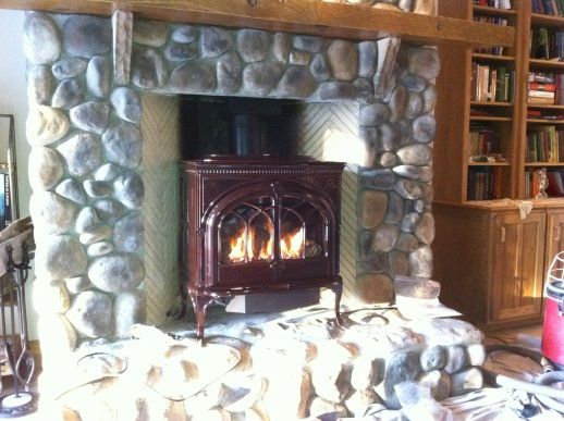Jotul woodstove w/ river rock surround. Want mantel with stove set back - 127 Best Images About Cast Iron Woodburning Stoves On Pinterest