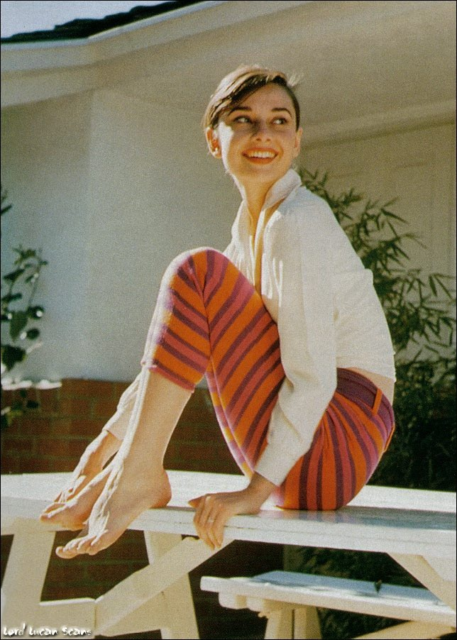 Audrey Hepburn - casual time at home - Capri's and a cropped shirt - perfection- what goes around comes around.