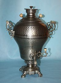 Russian samovar-a heated metal traditionally used to heat and boil water.  The hot water is typically used to make tea.