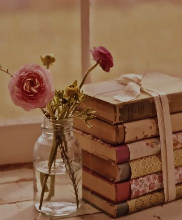 Book Club Meeting Decorations: A stack of pretty vintage books and flowers