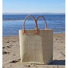 The perfect beach-basket  is handcrafted of ecological materials.