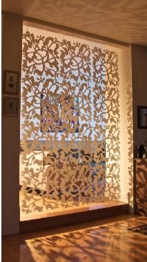 stencil windows to filter light and viewing inside home... I like this idea especially for a small country home... it looks kindda like vines...