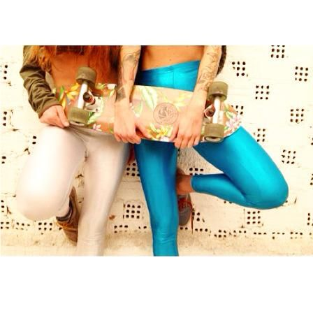 The white glitter and the cyan leggings