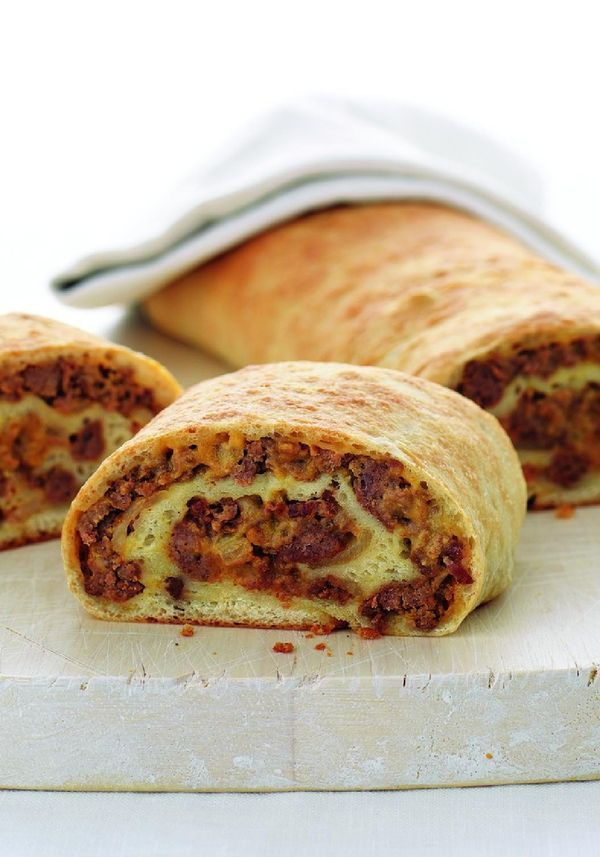 Bacon Cheeseburger Roll-Up — Be the mom who bakes ground beef, bacon, and ooey-gooey cheese into an ingenious spiral nestled inside a pizza crust. Accept the applause.
