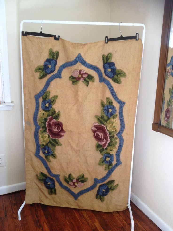 Vintage WALL HANGING Floral Burlap 40x60 Hook & Latch Rug Punch To Fix Art Craft Handmade Lovely hand crafted rug punch burlap rectangle artwork that is in need of a little love from a arts and crafts person. There are blue, pink and mauve flowers. Approximately 3 1/2 feet x 5 feet.
