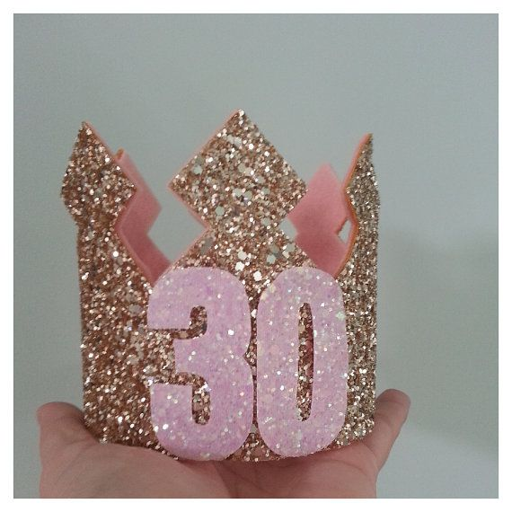 30th Birthday Glittery Crown  Birthday Glittery Metallic Gold Glitter Matetial lined with baby pink felt with a pink elastic headband. Pastel candyfloss 30 added to the front. Ready to ship in 3-5 business days as shown Measures approximately 3 3/4 High by 4 in diameter  Crown can be customized in many different colors. .Custom options available please email us.