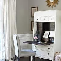 Courtney Hill Interiors - dens/libraries/offices - secretary desk, white secretary desk, curtains with ribbon trim, drapes with ribbon trim, grosgrain curtains, grosgrain drapes, grosgrain window panels, gold sunburst mirror, wainscoting, office wainscoting, wainscoting office,