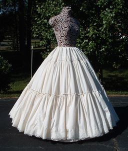 Petticoat, looks like multilayer white cotton to create a very full sweep, the weight of it all must be heavenly.