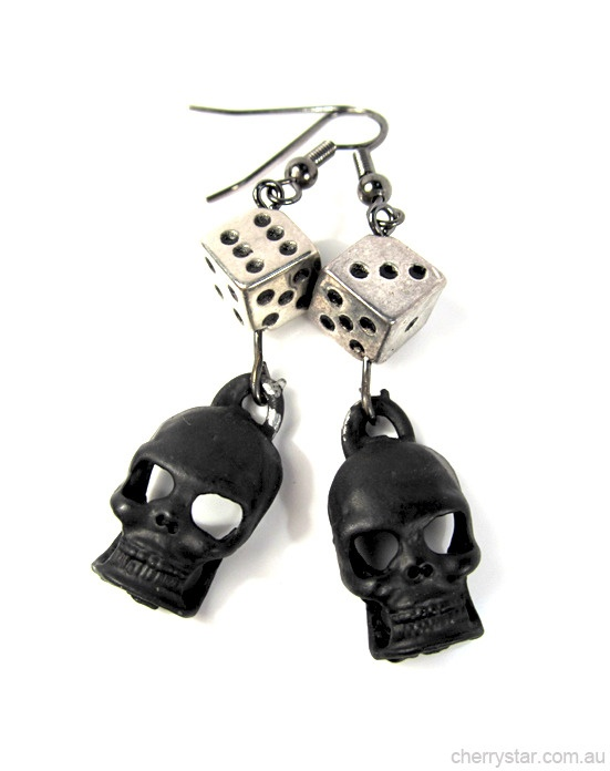 Matte black skulls and metallic dice earrings.  Larger than our other Skull & Dice earrings, the matte black and metal set each other off beautifully.  ***Last stock on sale do to a small amount of chipping on the paint. Item is AS SHOWN in photo***