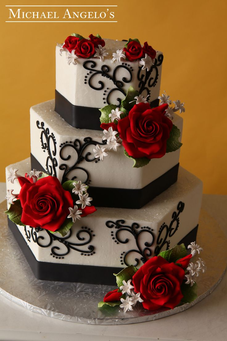 Rosie Red & Black #61Ribbons This design is hexagon-shaped with swirls and flowers along the sides of each layer. Any color ribbon or swirls can be placed on the cake to match your wedding. Gum paste flowers make a great topper and the fondant ribbon is a perfect way to had a short message for the bride and groom.