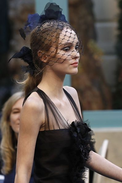 Chanel Pre-Fall 2017 | Lily Rose Depp presents a creation for Chanel during the 13th Métiers d'Art show on December 6 2016 in Paris