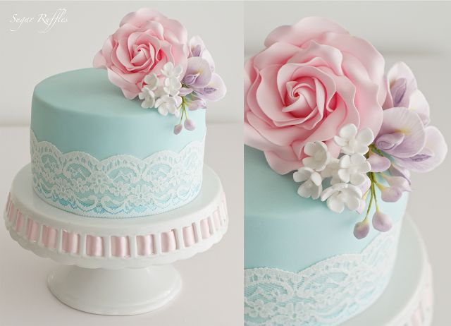 birthday cake topped with pink rose, wisteria and little white blossoms.....