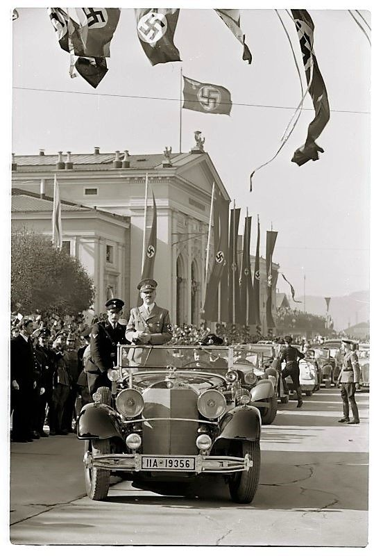 A rare photograph of Adolf Hitler and his motorcade cursing triumphantly down a Vienna boulevard upon the official proclamation of the Anschluss, the unification of Austria and the German Reich. 1938.