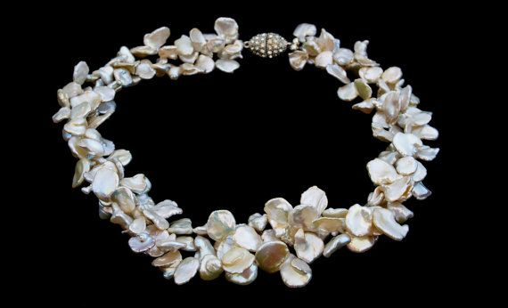 Check out this item in my Etsy shop https://www.etsy.com/listing/255298884/beautiful-keshi-pearl-necklace