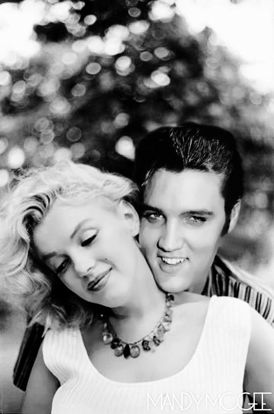 Marilyn Monroe and Elvis Presley. Definitely photo-shopped, as many of these 'images' are, but it's a nice  shot all the same…