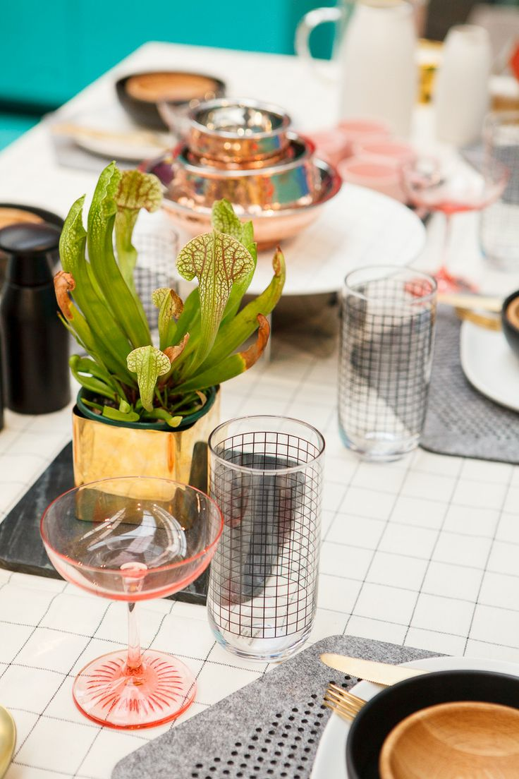 Table cloth, placemats, plates, bowls, jug, marble, glasses and plant all from Country Road. Blush cocktail glasses by Waterford from Myer. Gold cutlery from Myer. Cake stand by George Jensen from David Jones. Copper bowls from Wheel and Barrow.