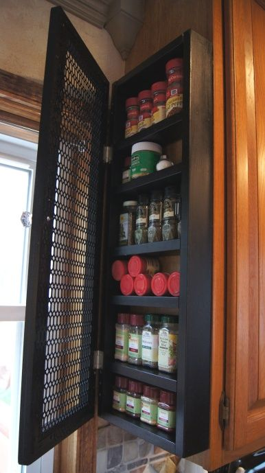 Running out of space inside your cabinets for your spices? From Confessions of a Serial Do-it-Yourselfers, here's a DIY spice cabinet that mounts on the end of your existing kitchen cabinet.