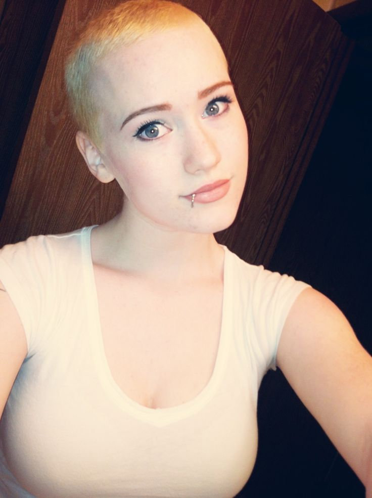 Busty female head shaved