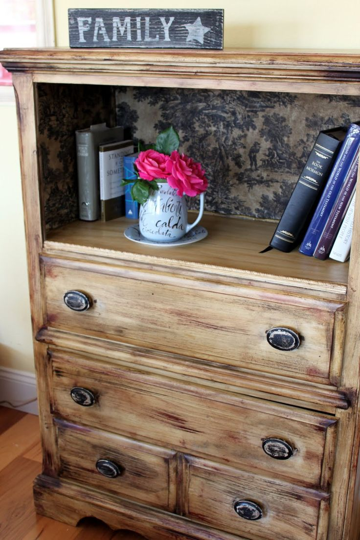 Idea to refinish a dresser: remove top drawer and stencil or paint the inside for a shelf. Great use in cases where junky dresser drawers don't work right. Could make it into a book shelf!! To do with our junker. :)