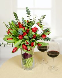 The beauty of red tulips gives vibrant and passionate notes to this 41 tulips bouquet decorated with eucalyptus and satin ribbon. A simple bouquet but with an attractive composition that would delight anyone. Order flowers online for someone you love and make unexpected surprises! We assure the bouquet delivery in Romania, in 2-4 hours. It is not difficult to create small joys! Being a bouquet with eucalyptus the surprise will be scented!
